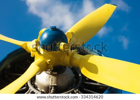 Detail of an old airplane's yellow propeller - stock photo
