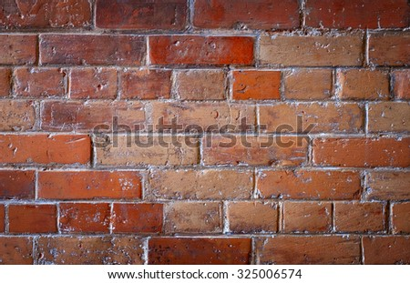 Detail of an old and damaged brick wall - stock photo