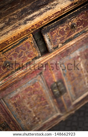 Detail of an old Chinese wooden dresser