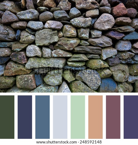 Detail of an old dry stone wall in a colour palette, with complimentary colour swatches.  - stock photo