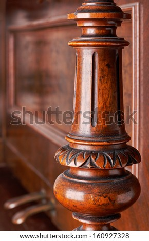 detail of an old German piano. A carved wooden decoration - stock photo
