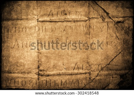 detail of an old gravestone altered with wrinkled paper texture for background textures - stock photo