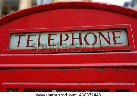 Detail of an old red telephone booth of London street. - stock photo