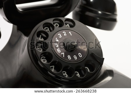 detail of an old rotary phone numbers - stock photo