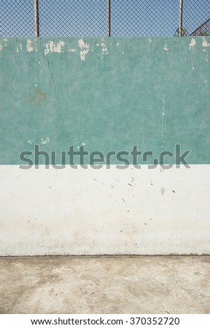 Detail of an old run-down tennis court - stock photo