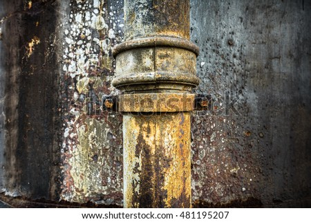 Detail of an old, rusty drain pipe