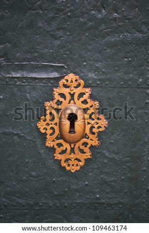 detail of an old steel door, painted with green paint, with the lock, close-up - stock photo