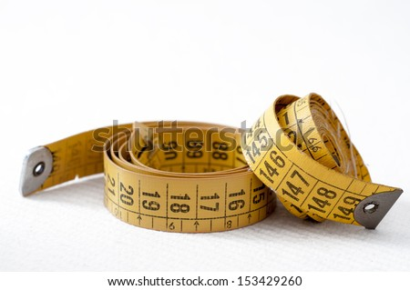 Detail of an old tape measure of tailoring - stock photo