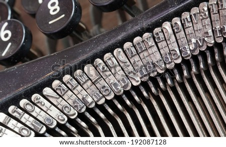 Detail of an old typewriter, machine of the 30s