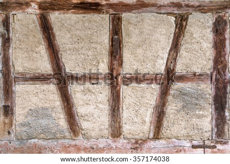 Detail of an old, weathered, brown half-timbered  - stock photo