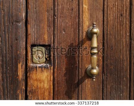 Detail of an old wooden door - stock photo