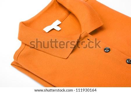 Detail of an orange polo shirt. - stock photo