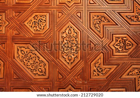 Detail of antique carved wooden ornament in Alhambra, Spain - stock photo