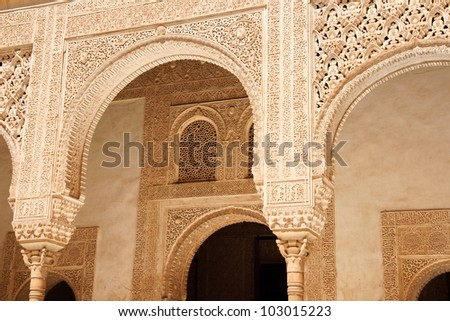 Detail of arabic carvings of Nasrid Palaces in the Alhambra of Granada in Andalusia, Spain