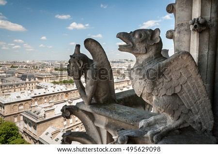 Detail of architecture of Notre Dame de Paris - chimera and bird