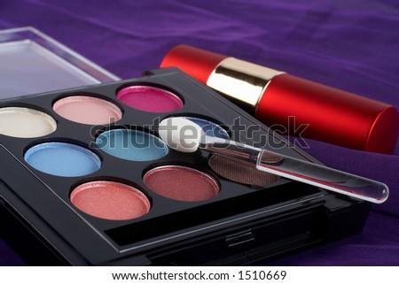 Detail of assortment of makeups.  Macro shot on malva background. Very shallow dof - stock photo