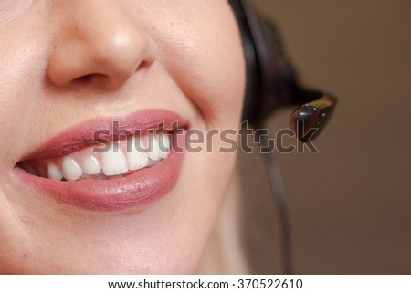 Detail of beautiful young call center agent at work - stock photo