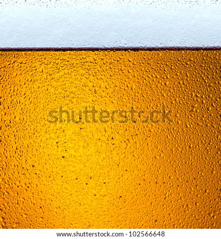 detail of beer in dewy glass - stock photo