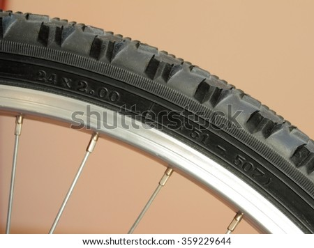 Detail of bicycle tire. Mountain bike tire with size numbers - stock photo