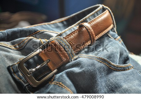 Detail of blue jeans with belt .Texture of blue jeans textile Close up.