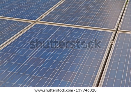 Detail of blue photovoltaic solar panel - stock photo