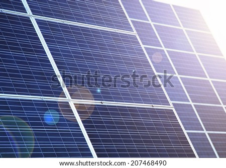Detail of blue solar panels with lens flare effect