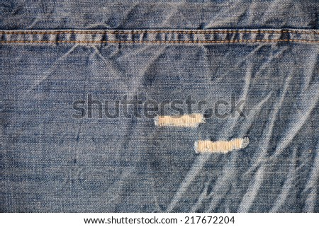 Detail of blue used jeans - stock photo