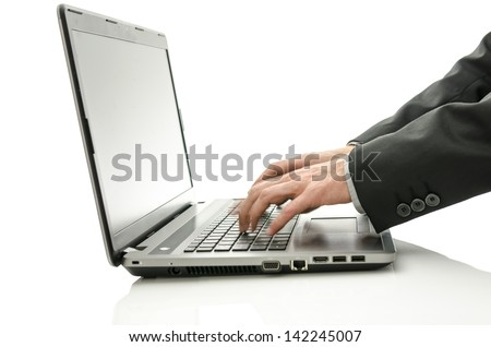 Detail of blurred hands using laptop. Isolated over white background.