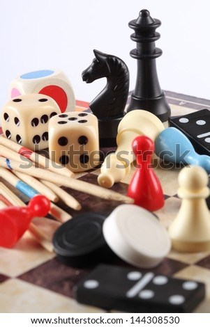 Detail of board games, pawns, chessmen, mikado and dices - stock photo