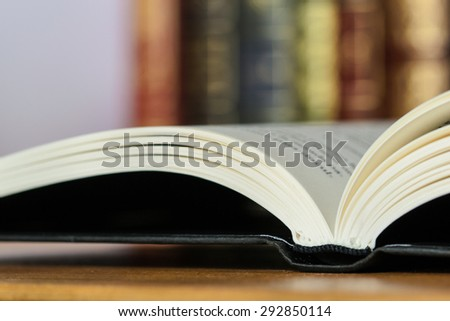 Detail of book on wooden table