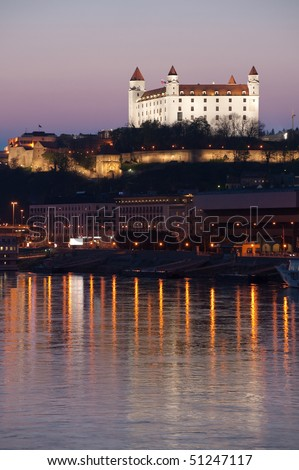 detail of Bratislava castle with it's reflection in Danube river, Slovakia - stock photo