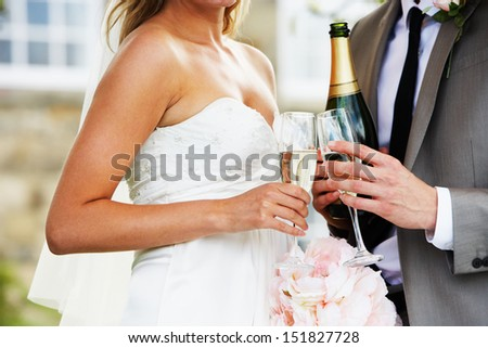Detail Of Bride And Groom Drinking Champagne At Wedding - stock photo