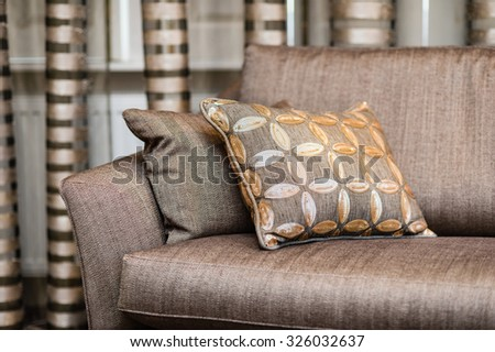 Detail of brown pillow on the brown sofa