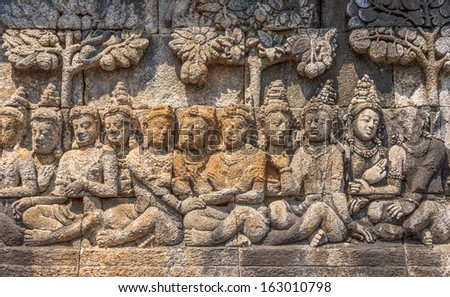 Detail of Buddhist carved relief in Borobudur temple - stock photo