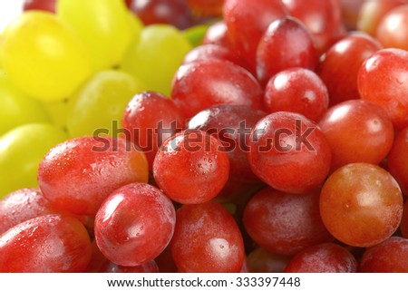 detail of bunches of red and white grapes