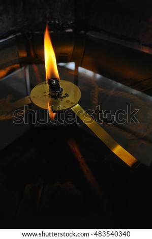 Detail of Burning Candle in Thai Buddhist Monastery