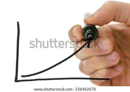 Detail of businessman hand drawing a growing graph on a virtual whiteboard. - stock photo