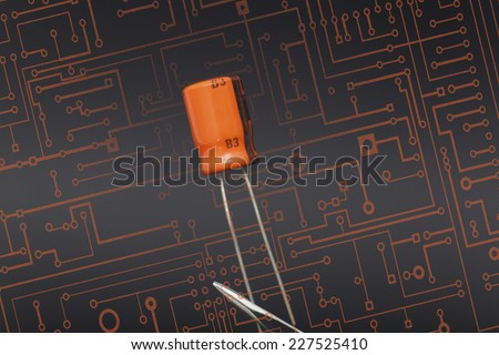 Detail of capacitor in black background - stock photo