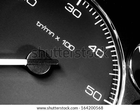 Detail of car dashboard. Closeup speedometer. Interior of car. Tachometer background.