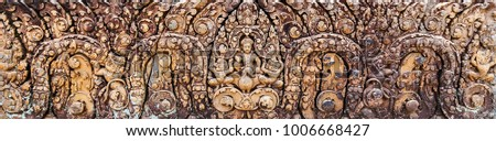 Detail of carvings background Bas-Relief Statue of Khmer Culture in Angkor Wat, Cambodia