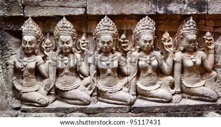 detail of carvings in angkor thom,UNESCO world heritage,cambodia. - stock photo
