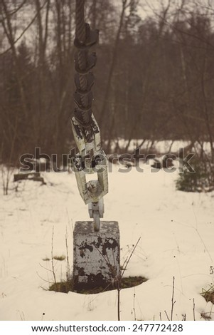 Detail of caterpillar track in construction site with dust and snow - aged photo effect, vintage retro - stock photo