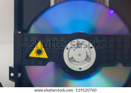 Detail of CD player and disk - stock photo