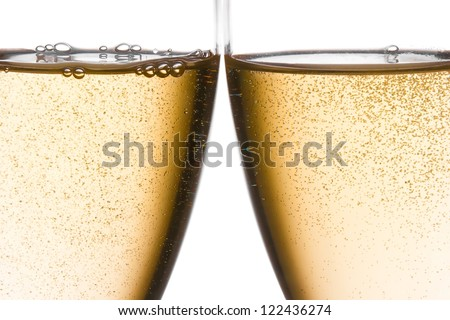 detail of cheers with two champagne glasses with gold bubbles on white background - stock photo