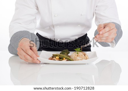 Detail of  chef add sauce to prepared food. White background - stock photo