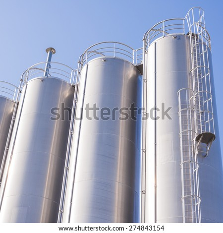 Detail of chemical plant, silos and pipes