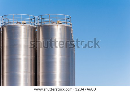 Detail of chemical plant, silos and pipes. Copy space