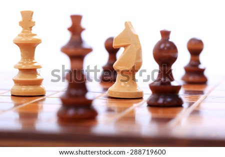 Detail of chess set on board - stock photo