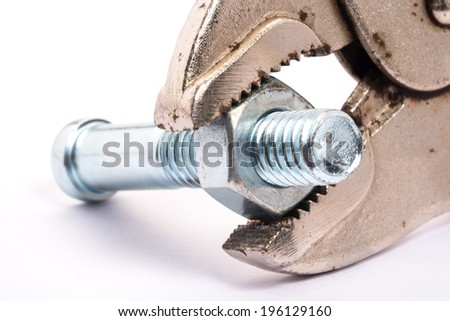 Detail of chrome wrench turning a nut on a bolt on white background - stock photo