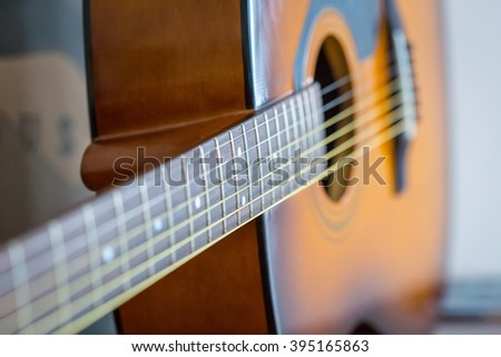 Detail of Classic Brown Guitar with Shallow Depth of Field